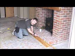 laminate wood floor against brick