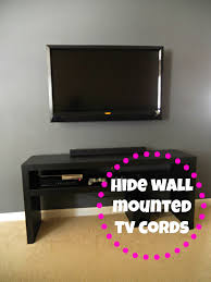 Hiding Wall Mounted TV Cords | Decorating Cents