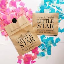 packets of blue and pink gender reveal confetti
