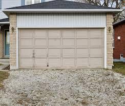 old garage door with a gravel driveway stock image image of gravel overgrown