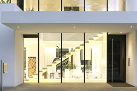outside design of house glass wall lit up at night house design