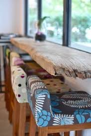 weathered wood table love the upholstered chairs would love this incorporated into kitchen bar love the stools and the bar concept but would clean up a