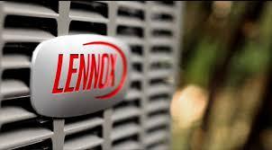 lennox logo. lennox logo on an air conditioning unit up close