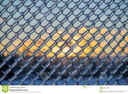 wire fence covering. Sunset Behind An Ice Covered Chain Link Fence Wire Fence Covering