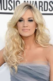 carrie underwood long curls carrie underwood wore her pale blond hair in long curls for the 2016 billboard awards
