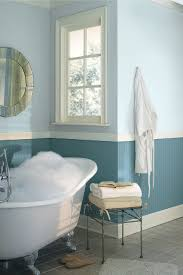 popular cool bathroom color:  cool two tone blue bathroom colors idea combined with white freestanding tub near wire table also