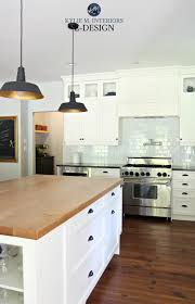 farmhouse country style kitchen cloud white cabinets black granite countertop butcher block island wood floor kylie m interiors edesign paint