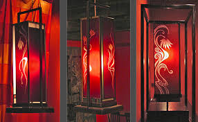 stained glass some are neon light boxes that can be hung on the wall like a painting others are a more modern take on the lamp shade with etching and