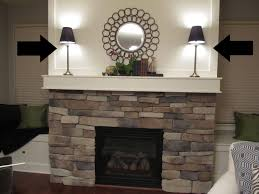 appealing stone fireplace surround kits with mantle shelf and table lamp
