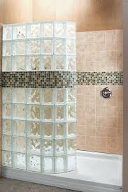 a curved glass block walk in shower wall with a decorative tile border innovate building