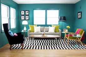 teal living room with black and white