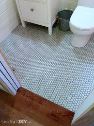 bathroom makeover hexagon floor tiles with painted grout lines transition to hardwood floor