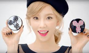 taeyeon gives off a cute look as she holds up two banila co image source banila co