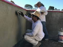 concrete block wall applying the stucco color coat