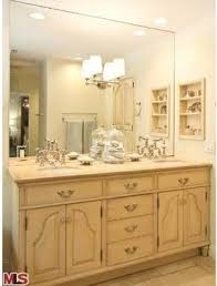 Barbara Stock Interior Design Custom vanity topped with Crema Marfil marble