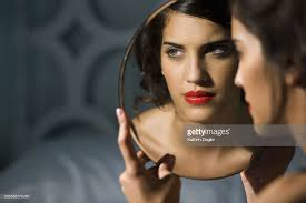 Young Woman Holding Mirror Focus On Reflection Stock Photo Getty