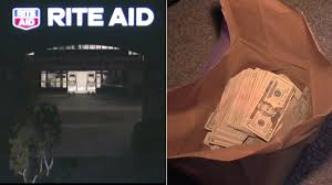 piles of cash was found in a car linked to one of four men who were taken into custody following a break in at a rite aid in tustin on wednesday march 16