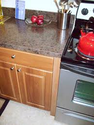 close up view of apartment kitchen cabinet countertop and stove