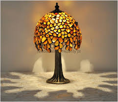 the ball small decorative table lamp the lamp is hand made from natural baltic amber it