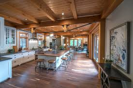 custom cabinetry from newwoodworks stretches under a bowstring truss in rob and melissa s kitchen