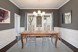 gray dining room chairs. Lovely Charcoal Gray Dining Room With Acrylic Chairs And Wooden Table [Design: Avenue B
