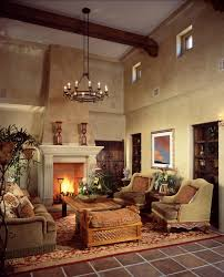 upstairs living room cozy sitting area tall yet cozy space here features natural carved wood coffee table sur