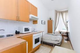 clean ground floor studio apartment with open plan kitchen and en suite shower wc