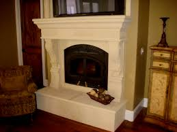 custom designed cast stone fireplace with plint box and decorative carved stone corbels for the mantel