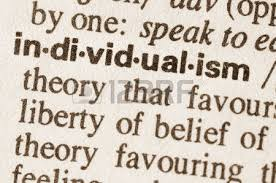 definition of word enigma in dictionary stock photo picture and  definition of word individualism in dictionary photo