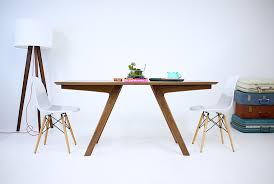 the boomerang mid century modern solid walnut dining table by robert william