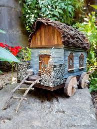 old lunch box turned into a gypsy caravan that s perfect for a fairy garden full