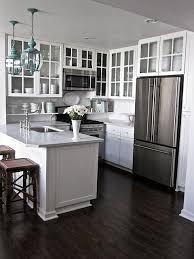 kitchen white cabinets dark hardwood floors white gray granite counters