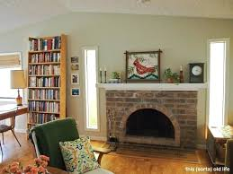 painting red brick fireplaces what color to paint living room with red brick fireplace can you