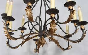 wrought iron nine light iron chandelier with gold leaf acanthus leaf design for