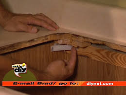 remove any clips or used to hold old countertop