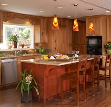 colorful pendant lights accentuate the red and yellow hues in the kitchen pendantlight