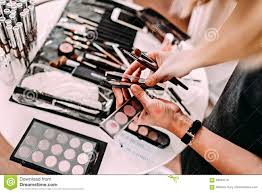 hands of a makeup artist workplace makeup artist set of brushes for makeup