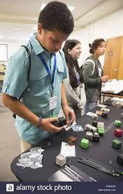 Byron Lawrence, Emmanuel Christian Academy seventh-grader, experiments with  robot cubes at the Air Force Research Laboratory booth Sept. 29, 2017, at  the Wright-Patterson Air Force Base, Ohio, STEM – Diversity Inclusion Event.