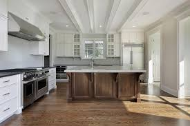 Here We Have A Natural Wood Square Island Seated Atop A Natural Hardwood  Floor In An