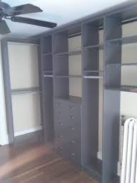 custom grey themed wooden closet with drawr ers using walk in closet design tool