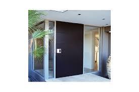 a timber pivot entrance door makes a bold design statement