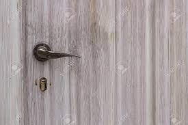modern door texture. Modern Chrome Door Handle On A Wooden Texture Background Stock Photo - 35825611 R