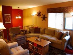 wall paint with brown furniture. Engaging Yellow Paint Color For Living Room : Red Wall With Glass Windows Plus Brown Furniture O