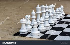 garden chess set. Giant Garden Chess Set Out For A Game Of Board