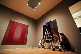 tate modern employees pose for the photographers in front of mark rothko s black on maroon