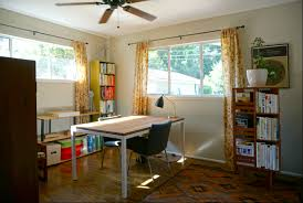 natural light office. One Of The Three Bedrooms, Being Used As An Office, With Ceiling Fan And Natural Light Office