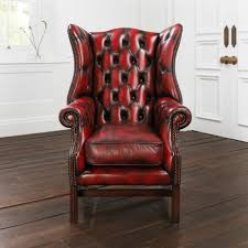 wingback chair. Red Leather Wingback Chair With Wooden Floor And White Wall For Home Interior Design Ideas