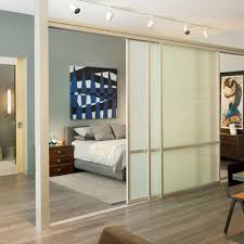 Inspiration for a contemporary medium tone wood floor bedroom remodel in  Los Angeles with gray walls