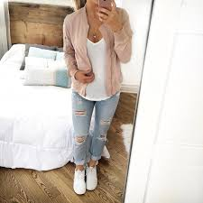 Light Wash Jeans Outfit Blush Pink Bomber Jacket Over White Tee Light Wash Ripped