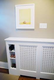 Entryway radiator cover with built in cubbies